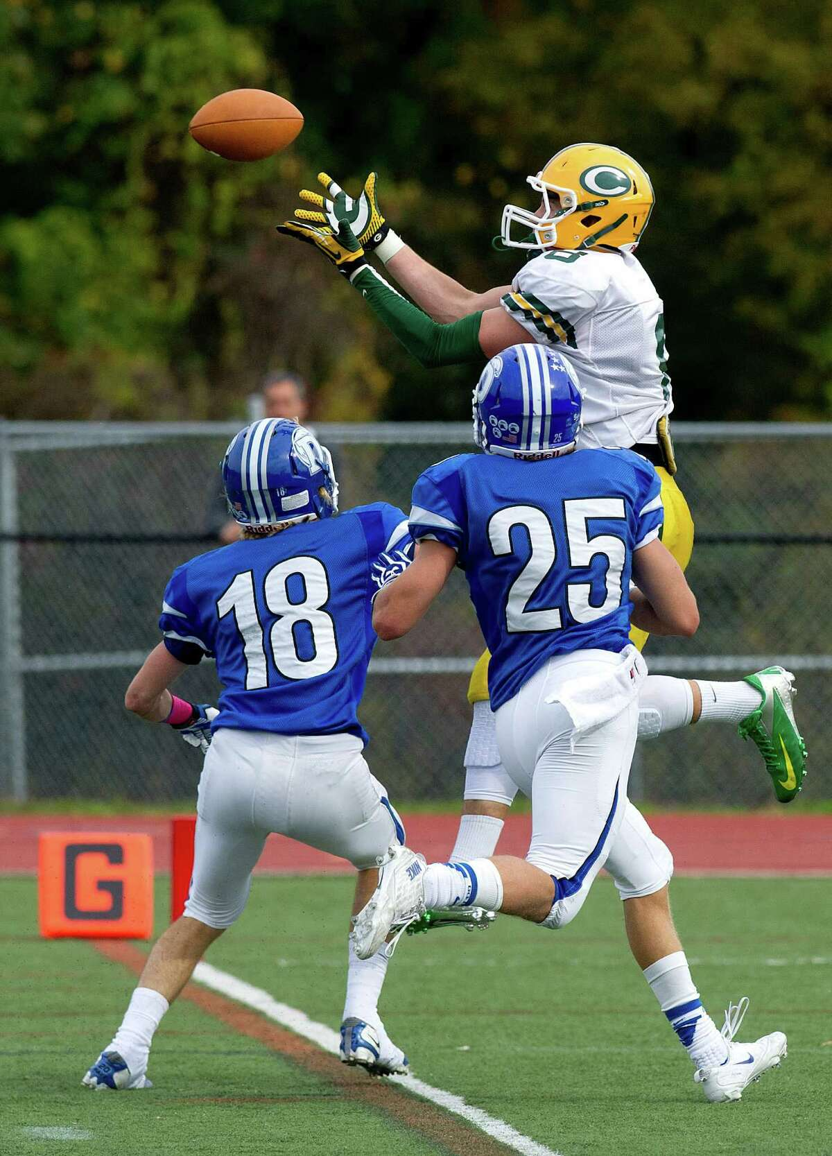 Trinity Catholic's Connor Amann makes a catch and scores a touchdown during Saturday's football game at Darien High School on October 19, 2013.