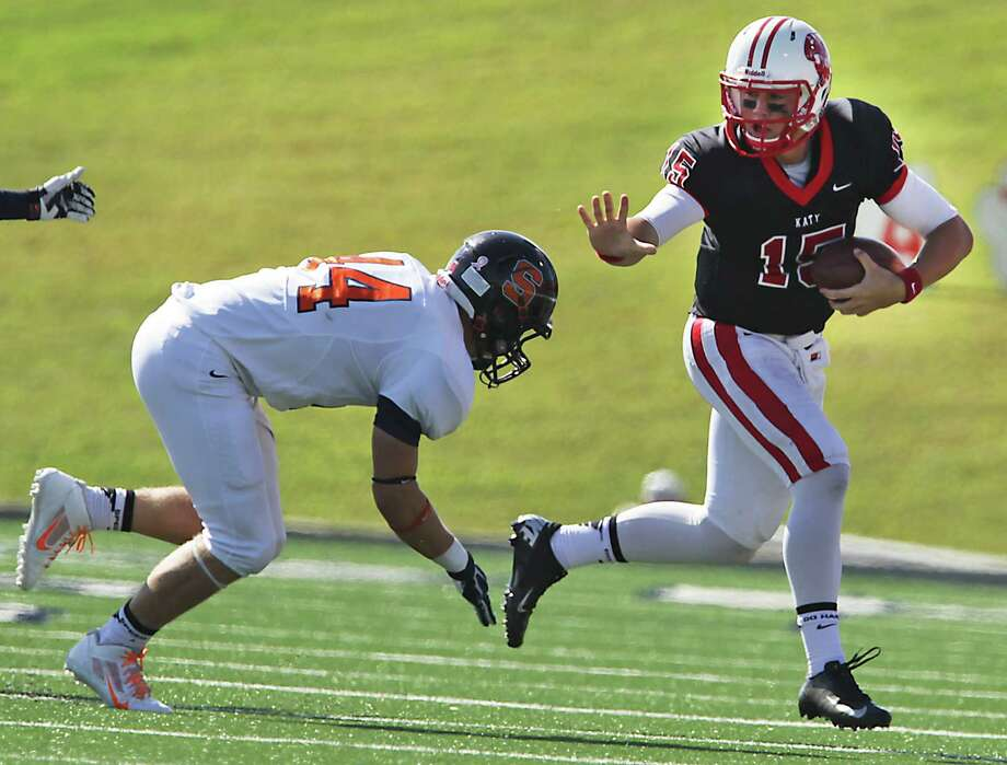 Katy's quarterback Kiley Huddleston right, runs with the ball  during the first quarter of high school football game action against Seven Lakes at Spring Branch ISD's Tully Stadium Saturday, Oct. 19, 2013, in Houston. Photo: James Nielsen, Houston Chronicle / © 2013  Houston Chronicle