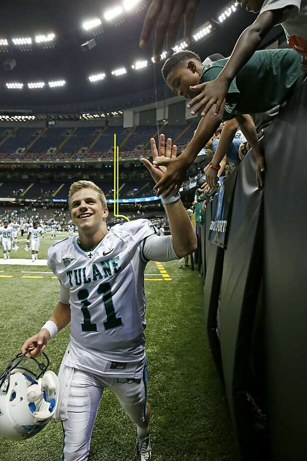 Tulane Green Wave quarterback Nick Montana (11) high fives fans after beating North Texas Mean Green 24-21 at the Mercedes-Benz Superdome in New Orleans on Saturday, October 5, 2013. By RUSTY COSTANZA/SPECIAL TO THE CHRONICLE Photo: Rusty Costanza, SFC