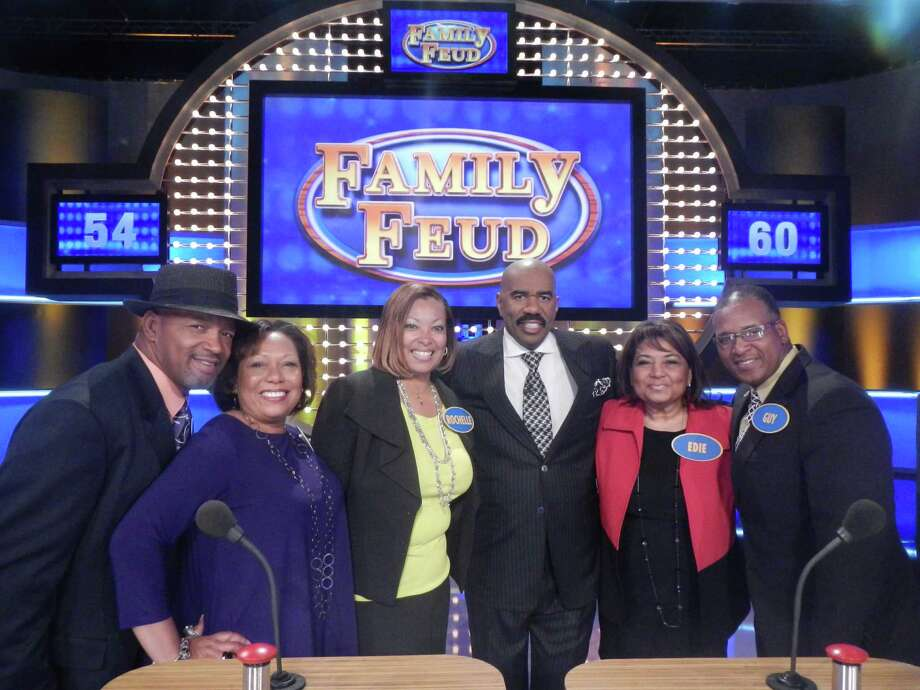 "The Roziers posing with host Steve Harvey, third from right, of ""Family Feud."" (Fremantle Media North America & Debmar-Mercury.)"