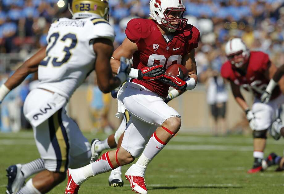 Stanford's Devon Cajuste, (89) with a first quarter first down reception, as the Stanford Cardinal takes on the UCLA Bruins at Stanford Stadium in Palo Alto, Calif. on Saturday Oct. 19, 2013. Photo: Michael Macor, The Chronicle