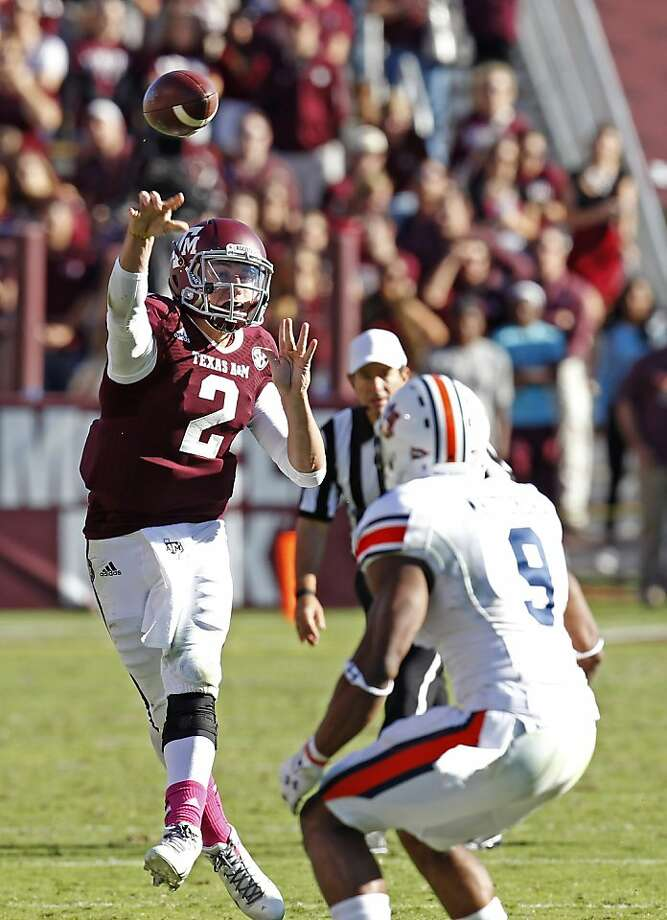 Texas A&M's Johnny Manziel passed for 454 yards and four touchdowns in the Aggies' loss to Auburn. Photo: Thomas B. Shea, Getty Images