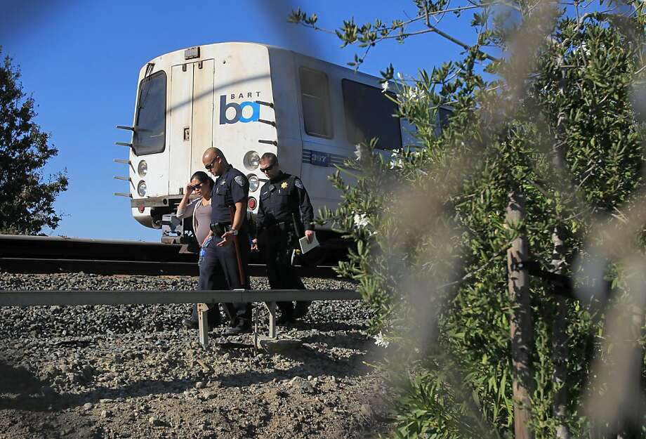 Police investigate the scene in Walnut Creek where a BART train struck and killed two workers. Photo: Leah Millis, The Chronicle
