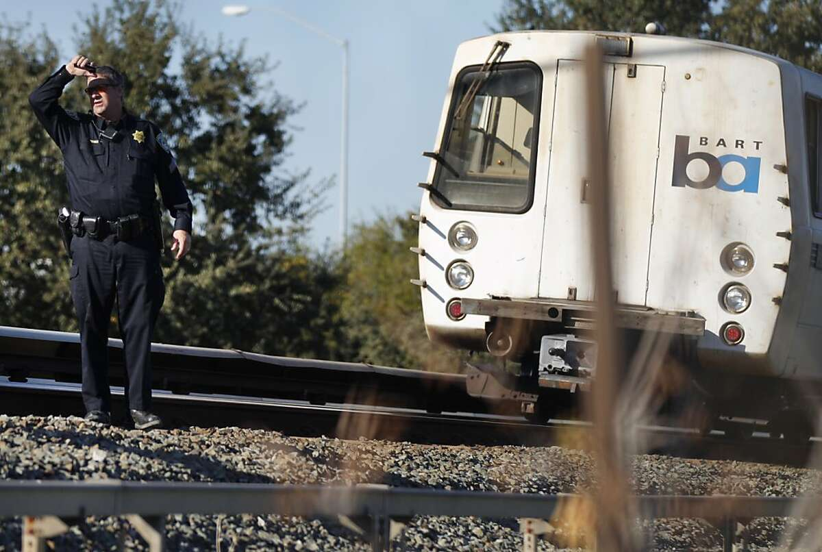 Police investigate an accident scene where a BART train struck two people, neither of which survived, October 19, 2013 in Walnut Creek, Calif.