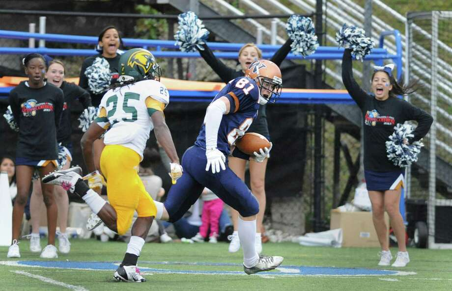 Western Connecticut wide receiver Connor Falaguerra (81) beats Fitchburg State defender David Dezeme (25) down the sideline for a first-quarter touchdown in the homecoming football game between Western Connecticut State and Fitchburg State at the Westside Athletic Complex in Danbury, Conn. on Saturday, Oct. 19, 2013. Photo: Tyler Sizemore / The News-Times