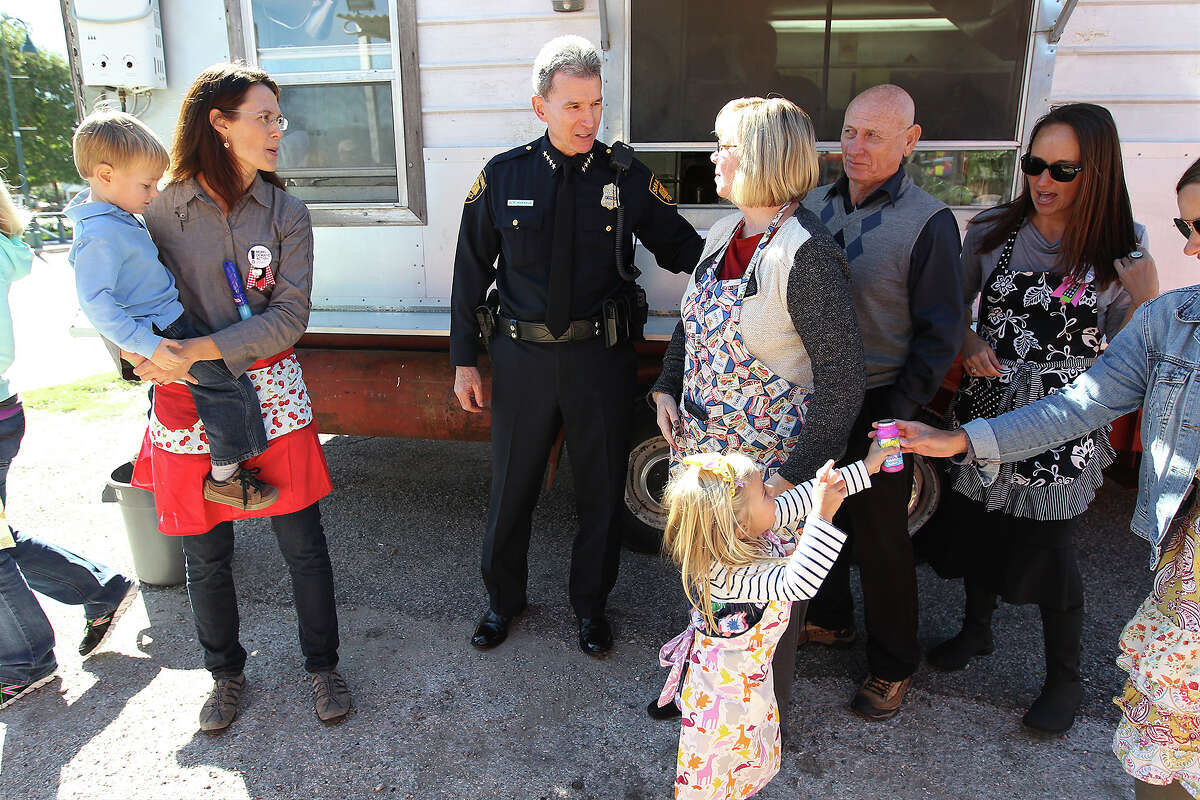 Chief William McManus (center) meets with members of Moms Demand Action during a counter gun rally on Saturday, Oct. 19, 2013. About two dozen people and their children colored, offered face painting and held a sign up to join the organization that strongly endorses background checks for prospective gun owners. McManus also spoke with Lonnie and Sandy Phillips (pictured beside McManus), the parents of Aurora mass shooting victim Jessica Ghawi, who attended the counter rally.