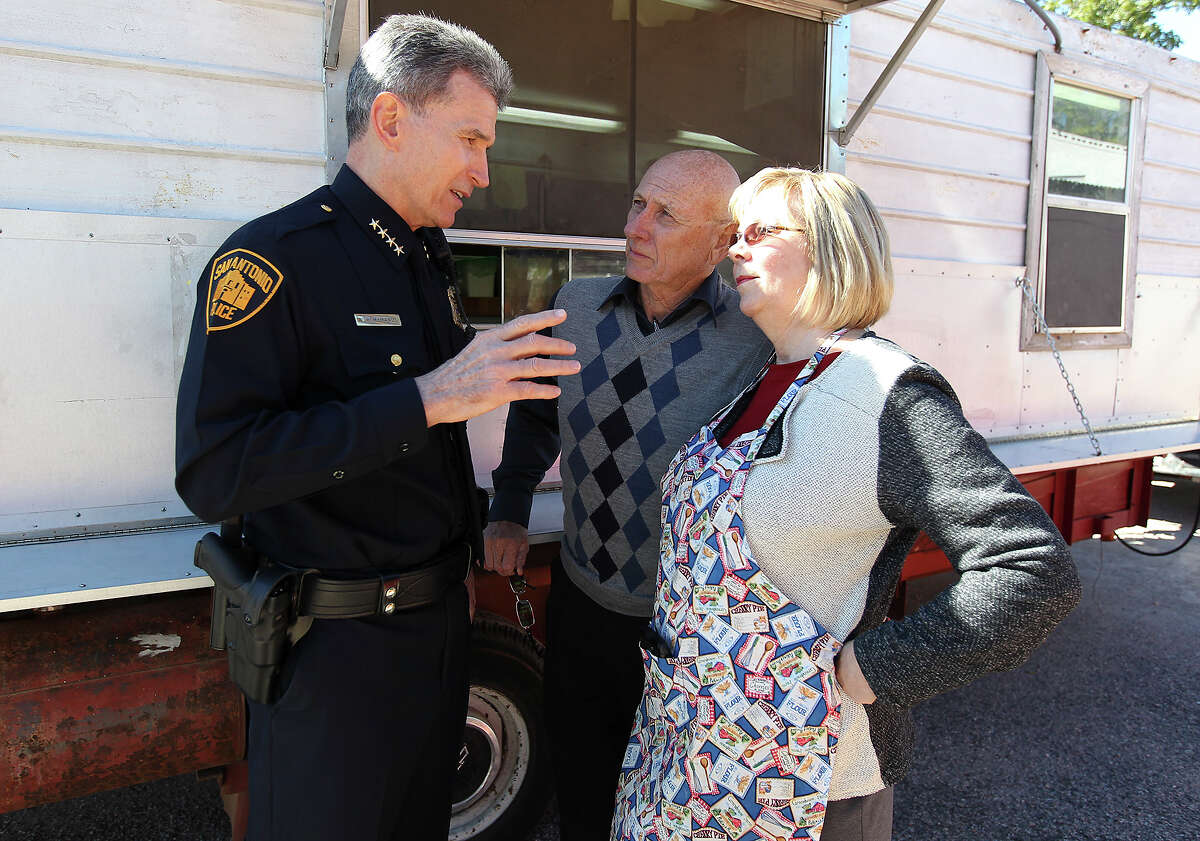 Chief William McManus (center) speaks with Sandy Phillips (right) and her husband Lonnie who lost their daughter, Jessica Ghawi, in the 2012 Aurora mass shooting during a counter gun rally by Moms Demand Action on Saturday, Oct. 19, 2013. About two dozen people and their children colored, offered face painting and held a sign up to join the organization that strongly endorses background checks for prospective gun owners.