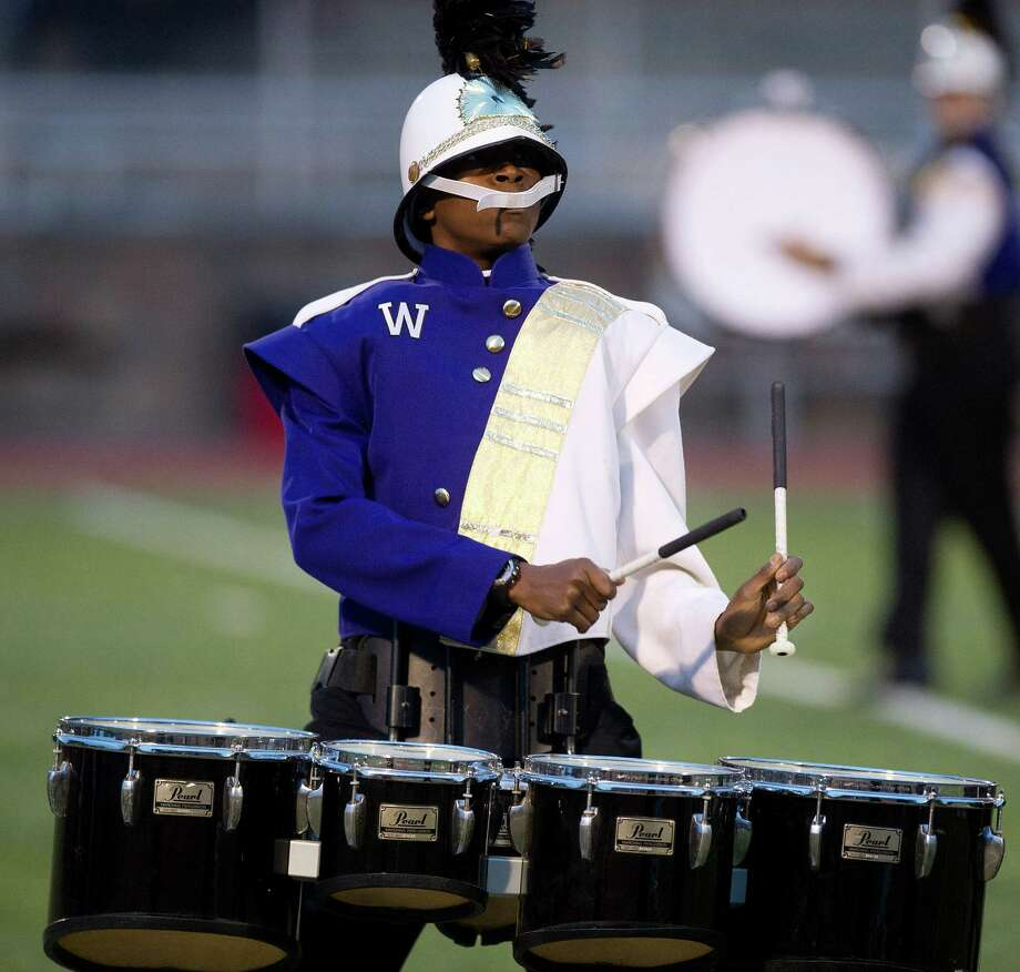 The Westhill High School marching band competes in Knight Music!, a regional marching band competition at Stamford High School on Saturday, October 19, 2013. Photo: Lindsay Perry / Stamford Advocate