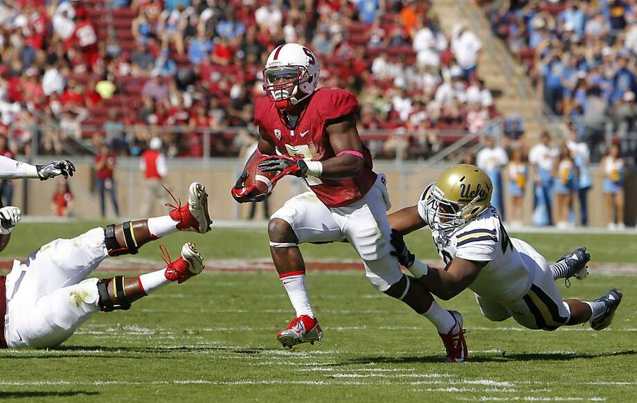 Stanford receiver Ty Montgomery, (7) on a first quarter reception run as the Stanford Cardinal takes on the UCLA Bruins at Stanford Stadium in Palo Alto, Calif. on Saturday Oct. 19, 2012. Photo: Michael Macor, The Chronicle