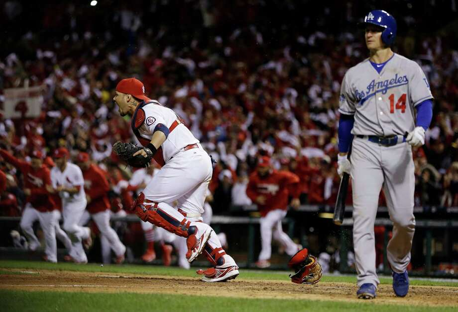 St. Louis Cardinals catcher Yadier Molina reacts after Los Angeles Dodgers' Mark Ellis strikes out to end Game 6 of the National League baseball championship series, Friday, Oct. 18, 2013, in St. Louis. The Cardinals won 9-0 to win the series. (AP Photo/David J. Phillip)  ORG XMIT: NLCS210 Photo: David J. Phillip / AP
