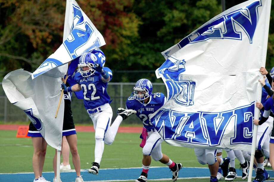 Saturday's football game against Trinity Catholic at Darien High School on October 19, 2013. Photo: Lindsay Perry / Stamford Advocate