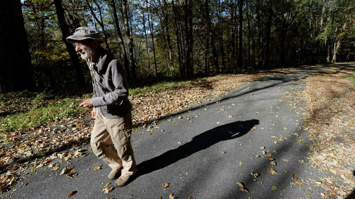 Property owner Frank Serpico cast a long shadow as he walks the path to his home Thursday morning Oct. 17, 2013, in Stuyvesant N.Y. (Skip Dickstein/Times Union