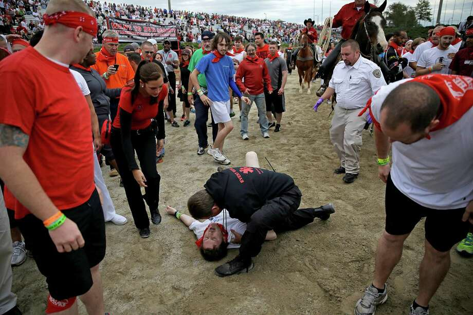 Bryant Knight, of Macon, Ga., is tended to by a medical official after being run over by a charging bull during the Great Bull Run at the Georgia International Horse Park, Saturday, Oct. 19, 2013, in Conyers, Ga. Photo: David Goldman, Associated Press / AP