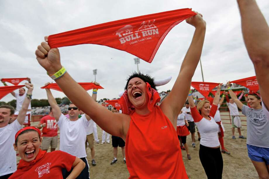 Megan Wright, right, and Jennifer Campbell, left, both of Mobile, Ala., chant with the crowd before running alongside charging bulls during the Great Bull Run at the Georgia International Horse Park, Saturday, Oct. 19, 2013, in Conyers, Ga. Photo: David Goldman, Associated Press / AP