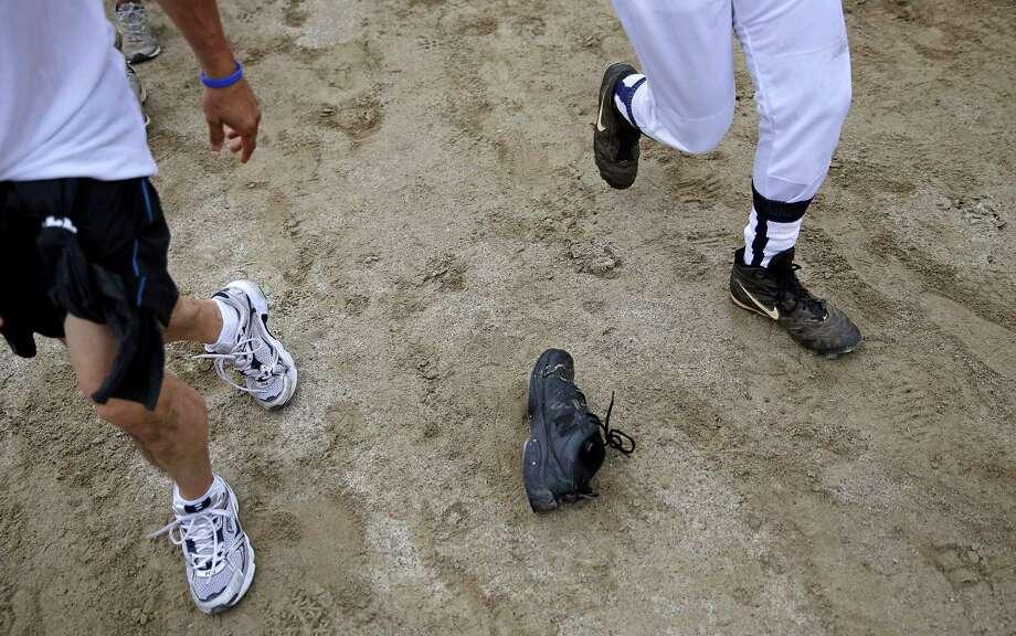 A shoe lies on the track as participants run alongside charging bulls during the Great Bull Run at the Georgia International Horse Park, Saturday, Oct. 19, 2013, in Conyers, Ga. Photo: David Goldman, Associated Press / AP