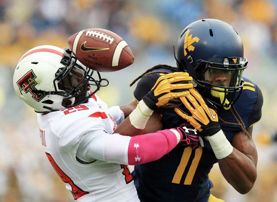 Texas Tech's Olauluwa Falemi, left, breaks up a pass intended for West Virginia's Kevin White. Photo: Chris Jackson, FRE / FR170573