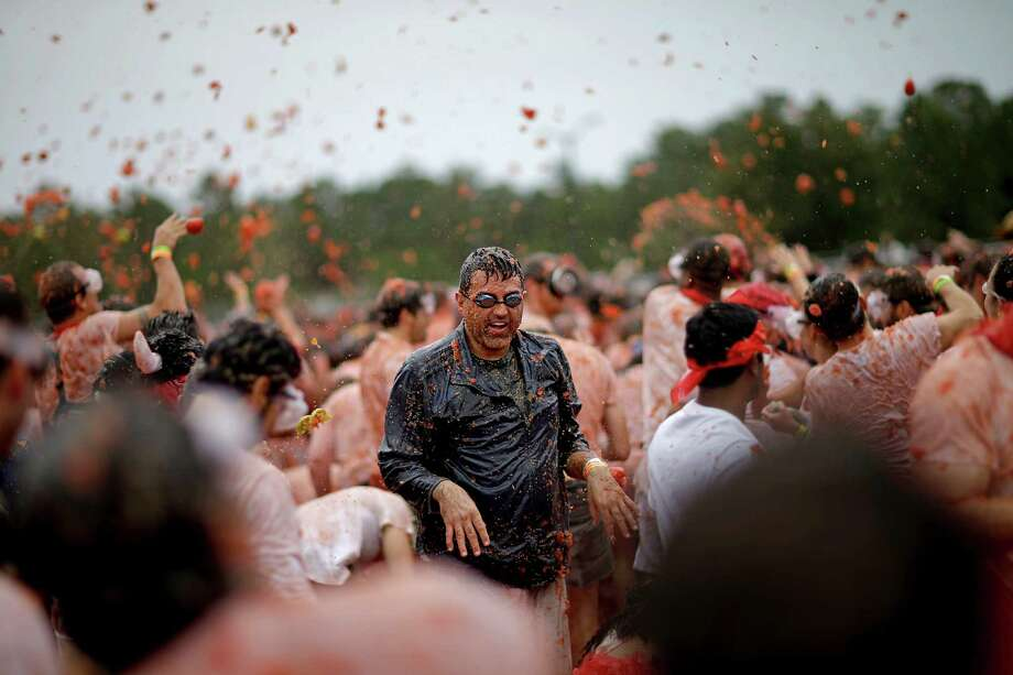 Participants engage in the Tomato Royale food fight as part of the Great Bull Run at the Georgia International Horse Park, Saturday, Oct. 19, 2013, in Conyers, Ga. Photo: David Goldman, Associated Press / AP