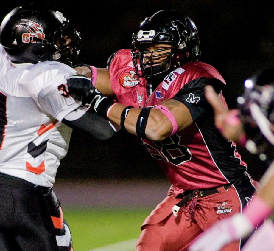 Connecticut Panthers' Ozzie Hill is roughed up by Western Connecticut Militia's Chansler Davis in the NEFL semifinals at Danbury High School. Saturday, Oct. 19, 2013 Photo: Scott Mullin / The News-Times Freelance