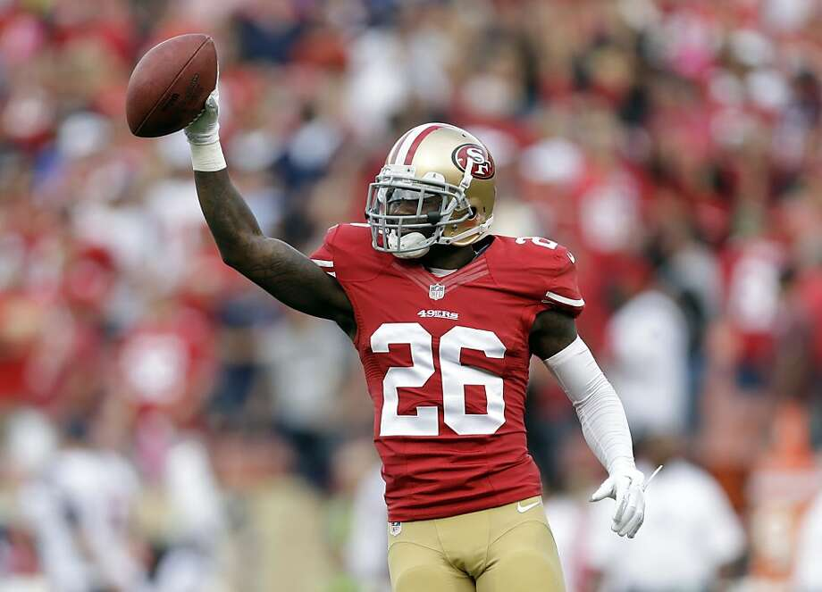 San Francisco 49ers cornerback Tramaine Brock (26) celebrates after scoring a touchdown in the first half an NFL football game against the Houston Texans in San Francisco, Sunday, Oct. 6, 2013. (AP Photo/Marcio Jose Sanchez) Photo: Marcio Jose Sanchez, Associated Press
