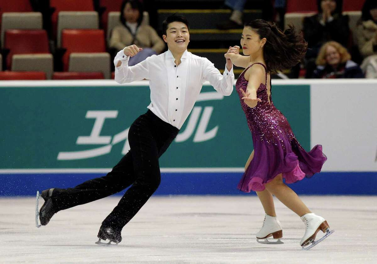 USA's Alex Shibutani and his sister Maia Shibutani compete in the short dance program at the Skate America figure skating competition in Detroit, Friday, Oct. 18, 2013. The pair finished the first round in third place. (AP Photo/Duane Burleson) ORG XMIT: MIDB115