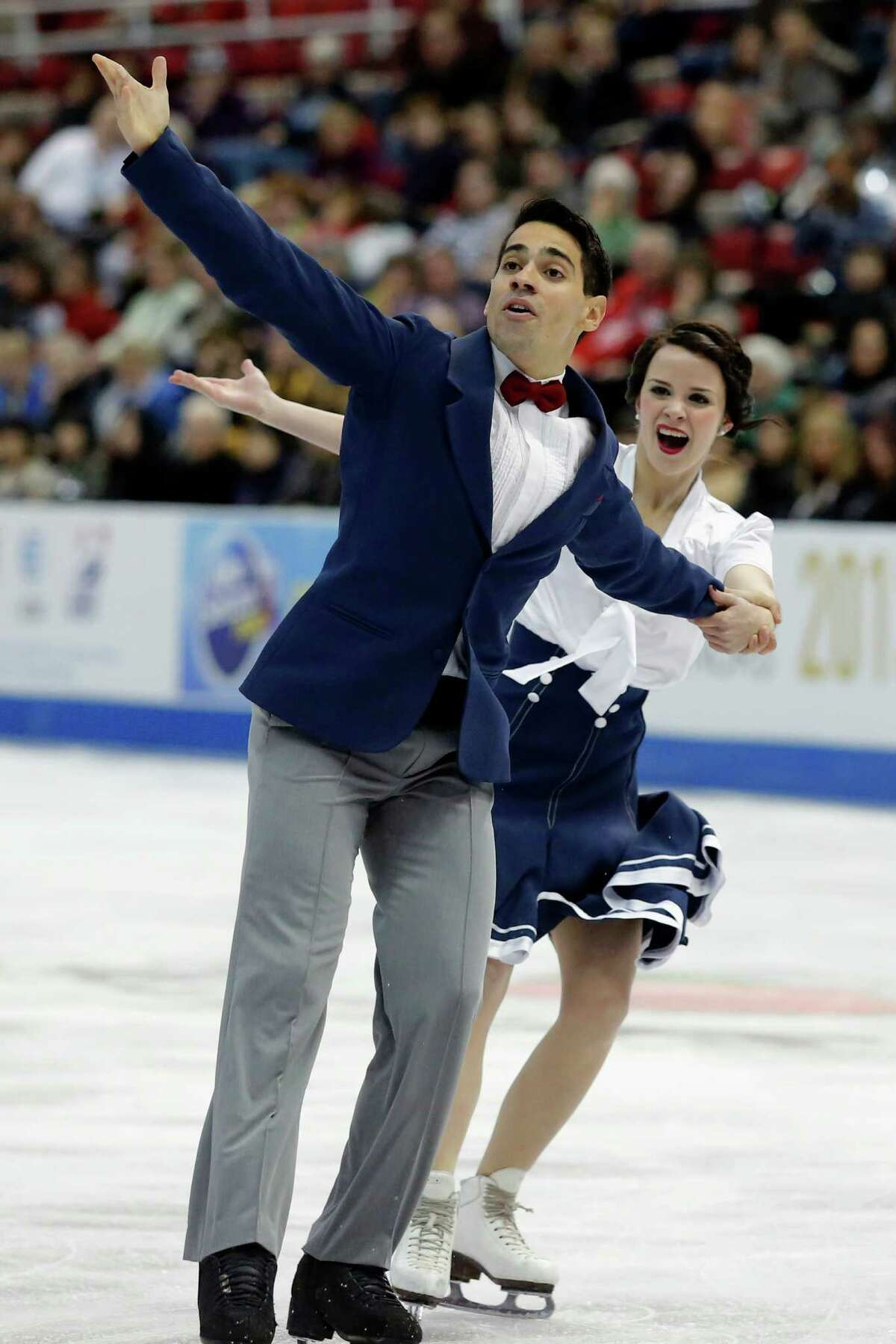 Anna Cappellini and Luca Lanotte perform in the short dance program at the Skate America figure skating competition in Detroit, Friday, Oct. 18, 2013. The pair took second place in the short dance program. (AP Photo/Duane Burleson) ORG XMIT: MIDB114