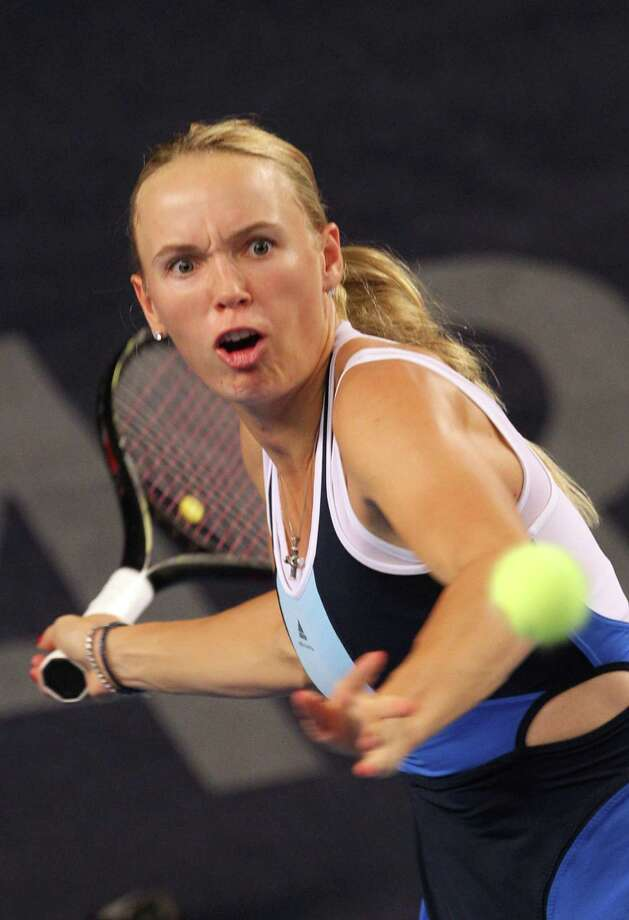 Denmark's Caroline Wozniacki returns the ball towards Germany's Sabine Lisicki, during the semi finals of the Luxembourg Open 2013, in Kockelscheuer, Luxembourg, Saturday Oct. 19, 2013. (AP Photo/Yves Logghe) ORG XMIT: YL115 Photo: Yves Logghe / AP