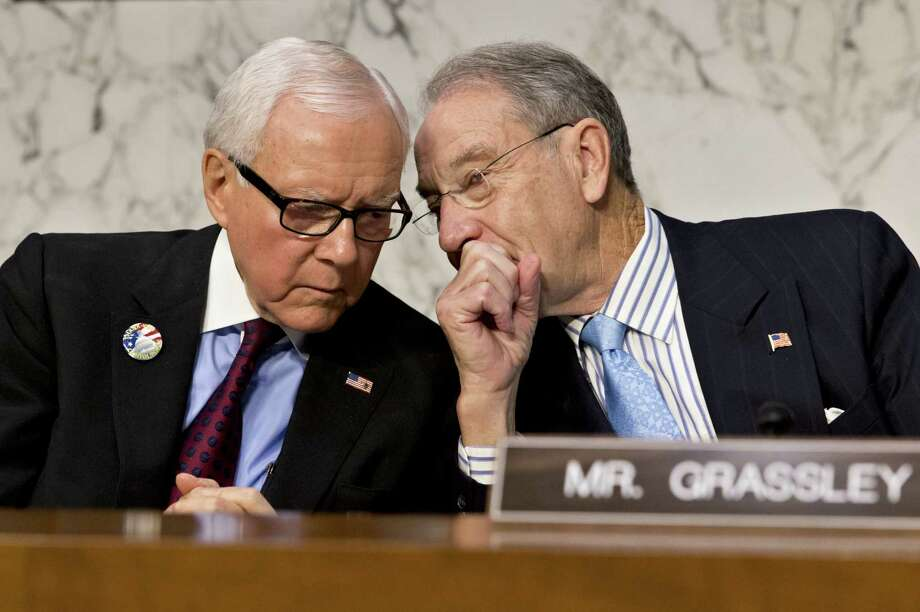 """Sen. Orrin Hatch, R-Utah (left), next to Sen. Chuck Grassley, R-Iowa, said the tea party's strategy to shut down the government """"was not a good maneuver."""" Photo: Pete Marovich / Bloomberg"""