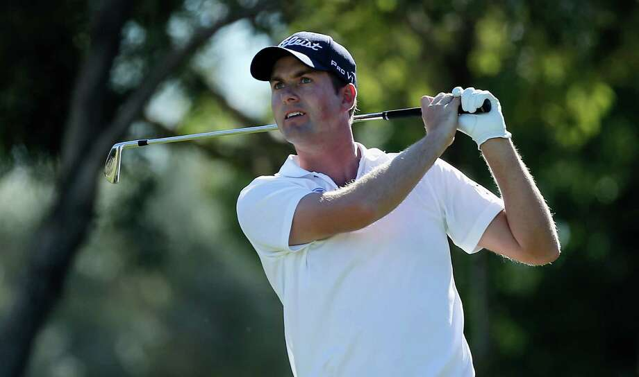 LAS VEGAS, NV - OCTOBER 19:  Webb Simpson watches his tee shot on the eighth hole during the third round of the Shriners Hospitals for Children Open at TPC Summerlin on October 19, 2013 in Las Vegas, Nevada.  (Photo by Scott Halleran/Getty Images) ORG XMIT: 177614646 Photo: Scott Halleran / 2013 Getty Images