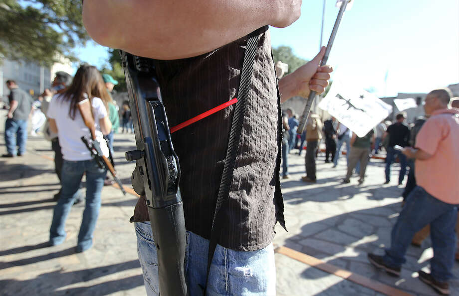 John Moltzer of Robinson, Texas carries his Hi-Point 9mm rifle at the Come And Take It San Antonio pro-gun rally on Saturday, Oct. 19, 2013. Photo: Kin Man Hui, San Antonio Express-News / ©2013 San Antonio Express-News