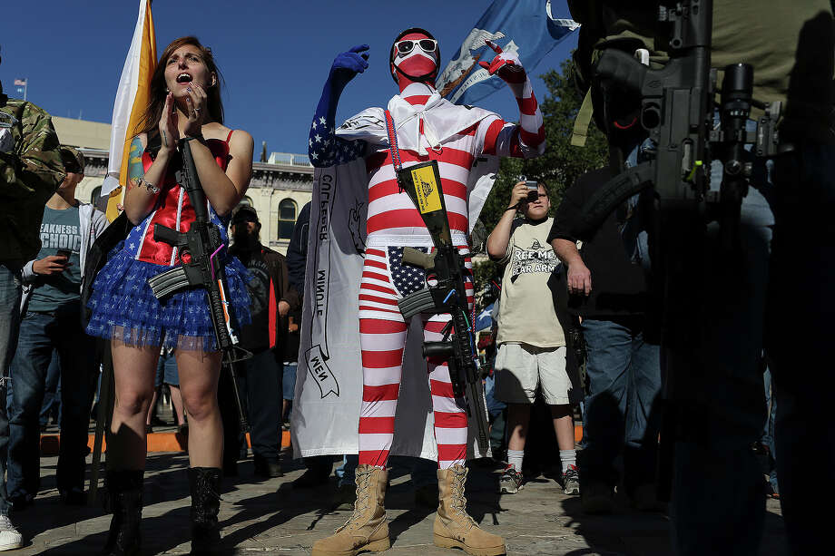 "Tom Jefferson, center, with Molly Pitcher, left, both of Austin, cheer during the ""Come and Take It"" rally at the Alamo on Saturday, Oct. 19, 2013. Photo: Lisa Krantz, SAN ANTONIO EXPRESS-NEWS / SAN ANTONIO EXPRESS-NEWS"