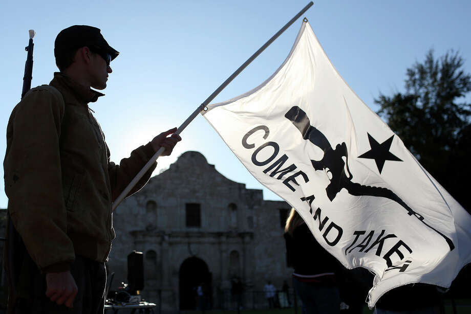 "Michael Devine, of Temple and a member of the Texas State Militia, waits for the ""Come and Take It"" rally to begin at the Alamo on Saturday, Oct. 19, 2013. Photo: Lisa Krantz, SAN ANTONIO EXPRESS-NEWS / SAN ANTONIO EXPRESS-NEWS"