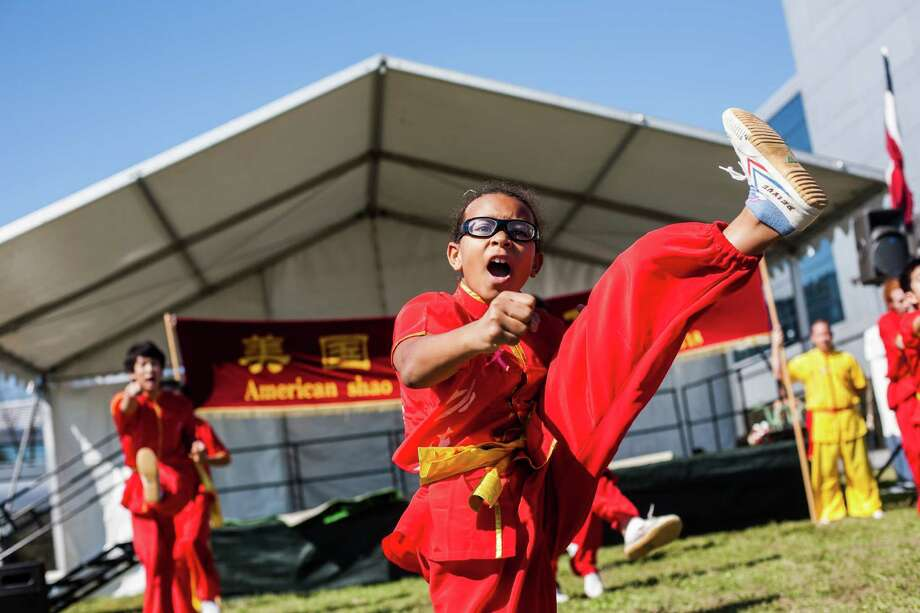A student from American Shaolin Kung Fu performs during the festival at the Houston Dragon Boat Regatta Saturday Oct. 19, 2013 in Sugar Land. Photo: Michael Starghill, Jr., For The Chronicle / © 2013 Michael Starghill, Jr.