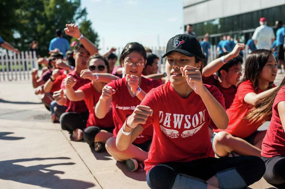 Cynthia Sun (front), a freshman at Dawson High School, and the Asian Culture Club practice their strokes before a race at the Houston Dragon Boat Regatta Saturday October 19, 2013 in Sugar Land. The team is made up of students from Dawson High School and Clear Lake High School. Photo: Michael Starghill, Jr., For The Chronicle / © 2013 Michael Starghill, Jr.