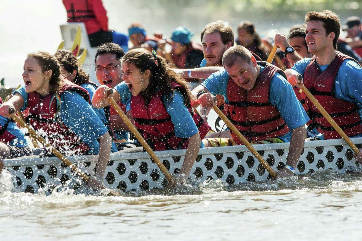 A dragon boat racing fights to win a race on Brooks Lake during the Houston Dragon Boat Regatta Saturday October 19, 2013 in Sugarland, TX.