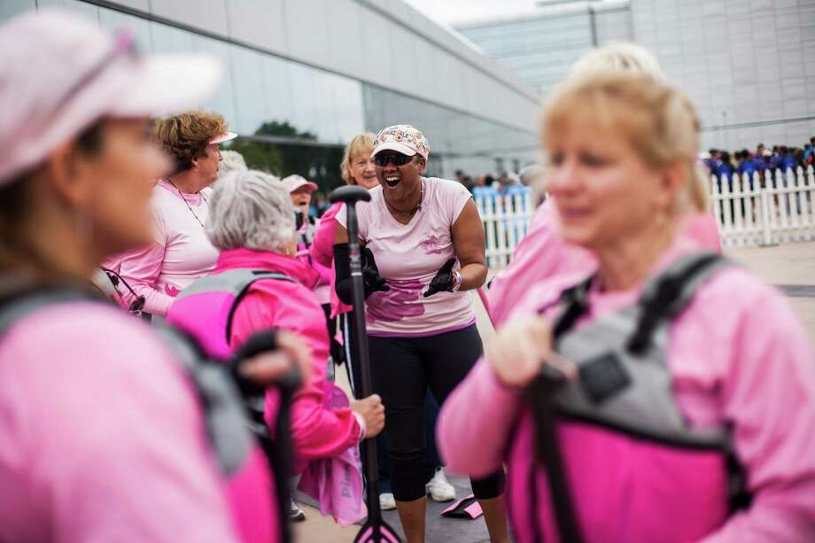 Tarshia Boutte talks to her Pink Phurree teammates before their race at the Houston Dragon Boat Regatta Saturday, Oct. 19, 2013 in Sugar Land. Pink Phurree is a dragon boat racing compiled entirely of breast cancer survivors. Photo: Michael Starghill, Jr., For The Chronicle / © 2013 Michael Starghill, Jr.