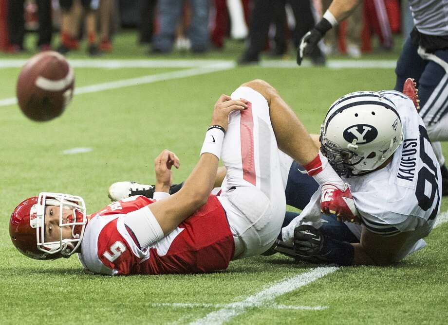 Oct. 19: BYU 47, UH 46Record: 5-1Houston quarterback John O'Korn watches the ball bounce away as he tries to lateral while being tackled by Brigham Young defensive lineman Bronson Kaufusi during the fourth quarter. Photo: Smiley N. Pool, Houston Chronicle
