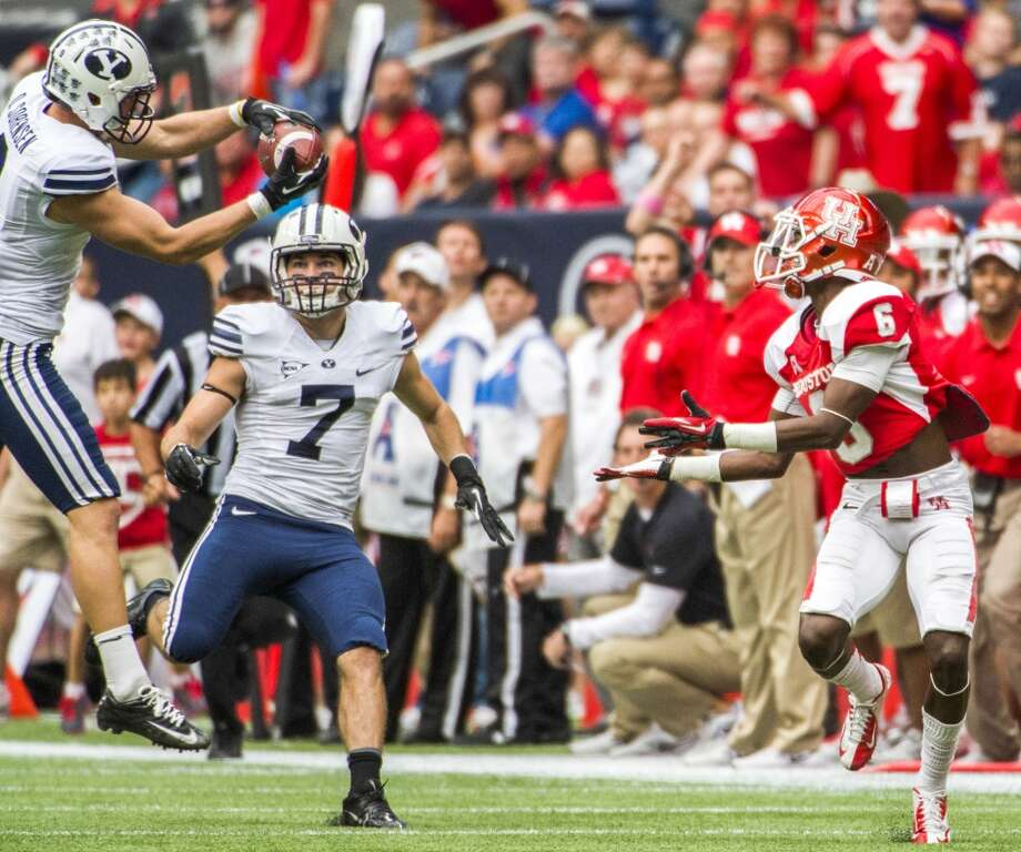 Brigham Young defensive back Daniel Sorensen intercepts a pass intended for Houston wide receiver Larry McDuffey. Photo: Smiley N. Pool, Houston Chronicle