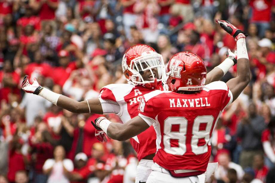 Houston wide receiver Xavier Maxwell (88) celebrates with wide receiver Larry McDuffey after catching a 69-yard touchdown pass during the first quarter. Photo: Smiley N. Pool, Houston Chronicle