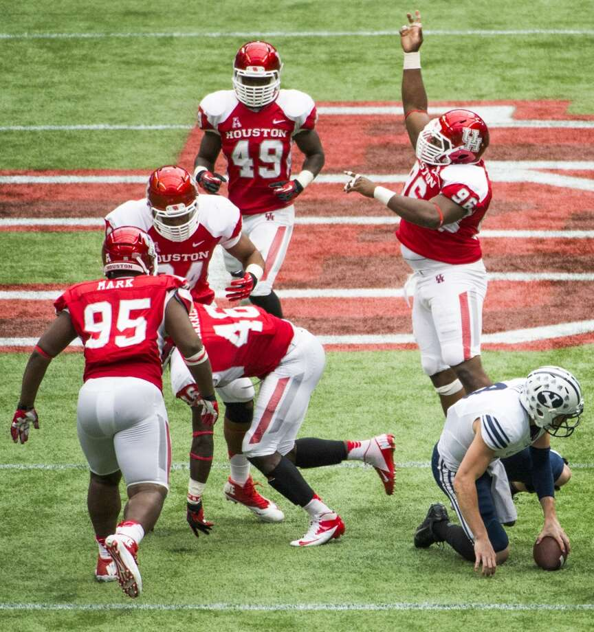 Houston defensive lineman Jeremiah Farley (96) celebrates after a sack by defensive end Trevor Harris (46) of Brigham Young quarterback Taysom Hill. Photo: Smiley N. Pool, Houston Chronicle