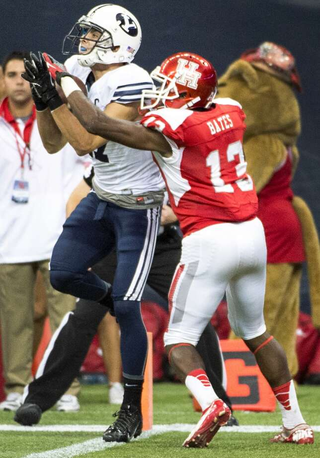 Brigham Young wide receiver Skyler Ridley catches an 11-yard touchdown pass as Houston defensive back Thomas Bates defends with just over a minute left to play to give BYU a 47-46 victory. Photo: Smiley N. Pool, Houston Chronicle