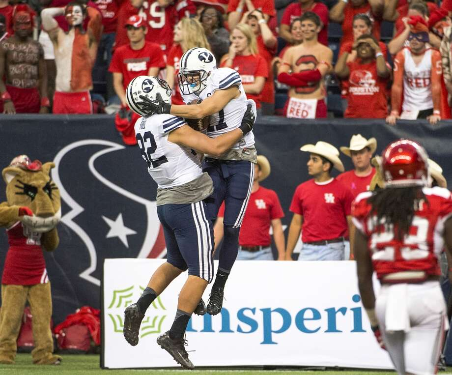 Brigham Young wide receiver Skyler Ridley celebrates with tight end Kaneakua Friel (82) after catching the game winner. Photo: Smiley N. Pool, Houston Chronicle