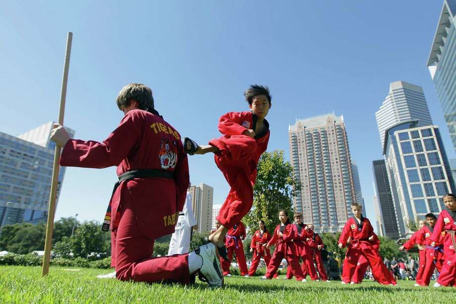 Bradley Sherman, left, and Andrew Jeong practice before the taekwondo performance at the Korean Festival at Discovery Green Saturday, Oct. 19, 2013, in Houston. Photo: James Nielsen, Houston Chronicle / © 2013  Houston Chronicle
