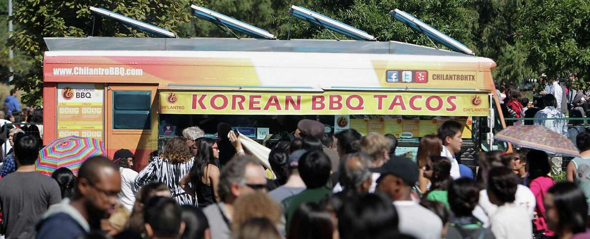 A line at the Korean BBQ Taco truck during the Korean Festival at Discovery Green Saturday, Oct. 19, 2013, in Houston.