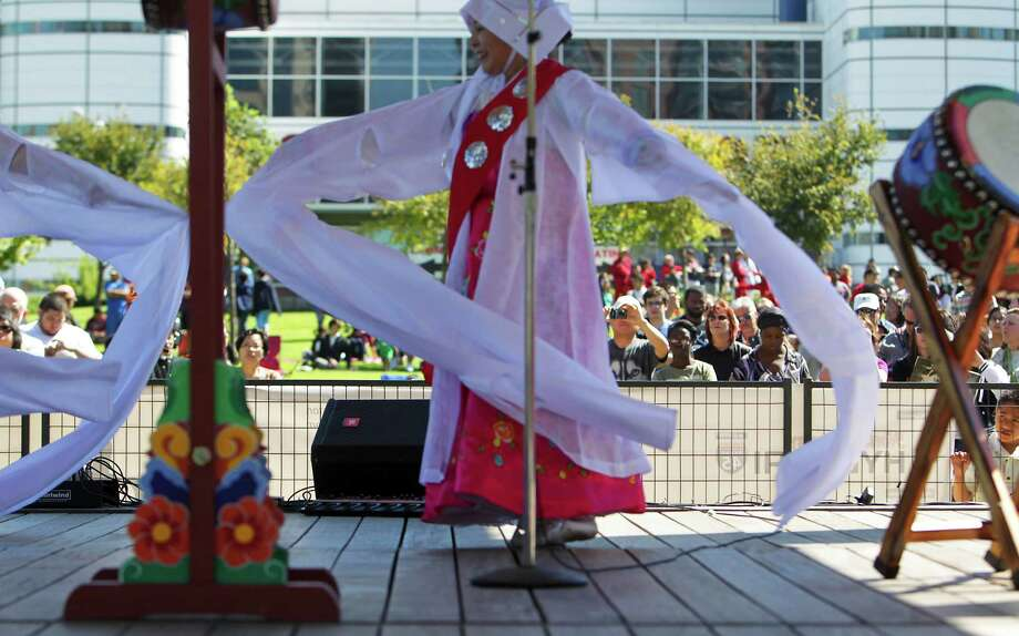 Sunhee Rheem during the drum performance at the Korean Festival at Discovery Green Saturday, Oct. 19, 2013, in Houston. Photo: James Nielsen, Houston Chronicle / © 2013  Houston Chronicle