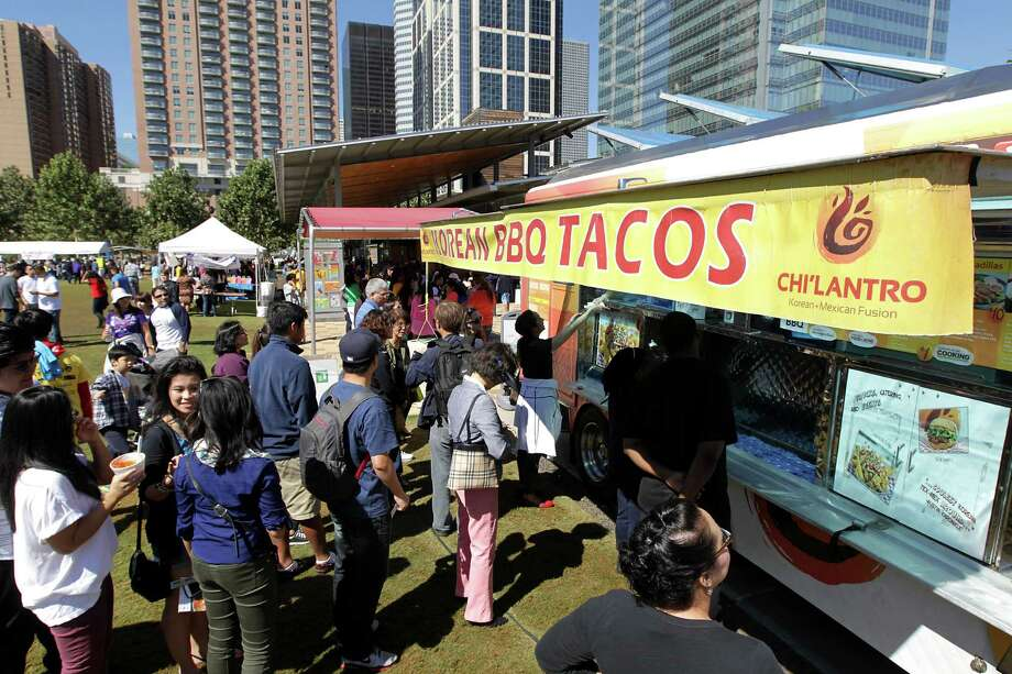 A line at the Korean BBQ Taco truck during the Korean Festival at Discovery Green Saturday, Oct. 19, 2013, in Houston. Photo: James Nielsen, Houston Chronicle / © 2013  Houston Chronicle