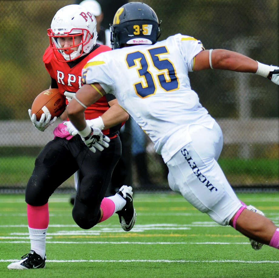 RPI's Matt Lane, left, carries the ball as Rochester's Tony Ortega defends during their football game on Saturday, Oct. 19, 2013, at Rensselaer Polytechnic Institute in Troy, N.Y. (Cindy Schultz / Times Union) Photo: Cindy Schultz / 00024273A