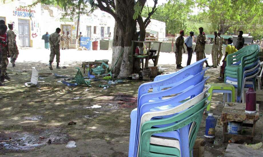 Security forces gather at the scene of a suicide bomb attack on a cafe in Beledweyne, Somalia. Islamist militant group al-Shabab claimed responsibility for the attack. Photo: Associated Press
