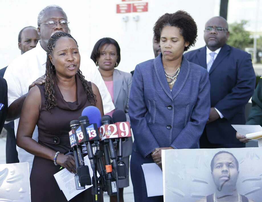 "Lillie Danzy (front left), mother of escaped inmate Charles Walker (pictured lower right), says she had told him, ""We love you. We believe in you. We just want you to surrender yourself,"" before he was captured. Photo: John Raoux / Associated Press"