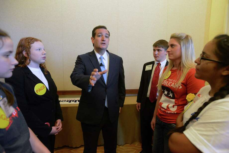 U.S. Sen. Ted Cruz meets with pages at the Texas Federation of Republican Women State Convention in San Antonio on Saturday, Oct. 19, 2013. Cruz is back in the state following his efforts to defund Obamacare by forcing a federal budget showdown. Photo: Billy Calzada, San Antonio Express-News / San Antonio Express-News