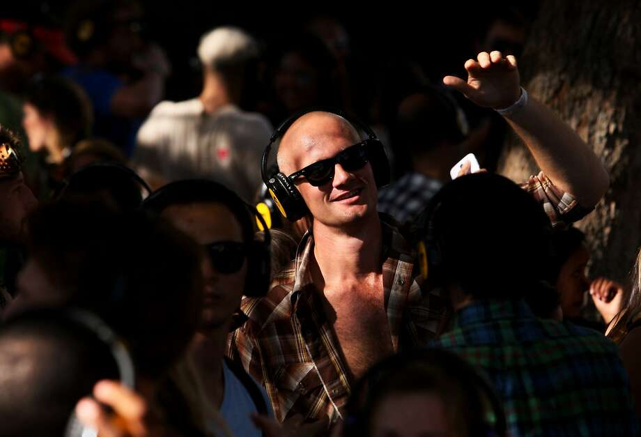 Hudson Arnold of San Francisco dances at the Silent Frisco area where the crowd listens to a DJ through wireless headphones at the Treasure Island Music Festival in San Francisco, Calif. on Saturday, Oct. 19, 2013. Photo: Raphael Kluzniok, The Chronicle